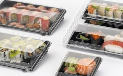 Sushi beautifully presented in plastic trays with clear lids - Plus Pack