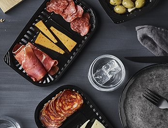 Black VistoPac rPET trays with tapas, cheese selection and olives - Plus Pack