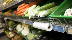 Supermarket vegetable section with close-up of plastic bag roll, Food waste, DTU study - Plus Pack