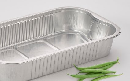 Aluminium, ready2cook container on grey background with green beans